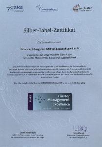 Klaus-Dieter Bugiel, Geschäftsstellenleiter des Netzwerk Logistik Mitteldeutschland e. V. mit dem Silber-Label der European Cluster Excellence Initiative